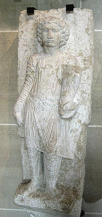 A statue of a young Palmyran in fine Parthian trousers, from a funerary stele at Palmyra, early 3rd century AD YoungManWithParthianCostume.jpg