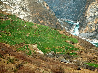 Tiger Leaping Gorge - Terraces part way up the sides of the Tiger Leaping Gorge