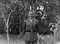 (Portrait of a military serviceman standing amid plants and trees) (AM 76646-1).jpg