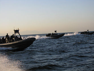 Philippine Navy - Philippine Navy rigid hull inflatable boats perform a maritime interdiction operation exercise in Manila Bay.