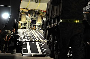 No. 36 Squadron RAAF - C-17 loading a JGSDF truck as part of the humanitarian response to the 2011 Tōhoku earthquake and tsunami