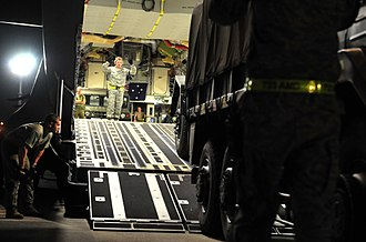 No. 36 Squadron RAAF - C-17 loading a Japan Ground Self-Defense Force truck as part of the humanitarian response to the 2011 Tōhoku earthquake and tsunami