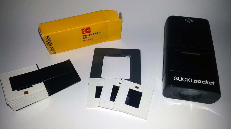 110 film small-format slides, with box, plastic holder, slide adapter and pocket viewer