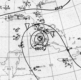 Map showing shorelines and the coordinate grid in light gray. Black contours on the map denote isobars; the presence of concentric isobars at the center of the image denote the location of a tropical cyclone.