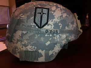 Advanced Combat Helmet - An ACH with a UCP helmet cover and the 1st MEB patch