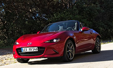Mazda MX-5, the world's best selling sports car 2015 Mazda MX-5 ND 2.0 SKYACTIV-G 160 i-ELOOP Rubinrot-Metallic Vorderansicht.jpg