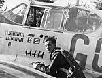 355th Fighter Squadron Lieutenant William B.King before the picture of the P 51B Georgia Peach.jpg