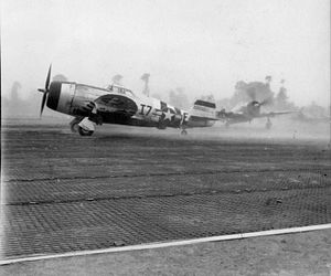 Deux Jumeaux Airfield - P-47 Thunderbolts of the 48th Fighter Group line up for take off at Deux Jumeaux Airfield