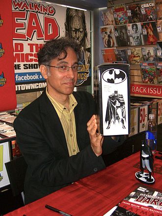 Batman Black and White - Artist David Mazzucchelli with the statue based on his artwork in the series at a June 28, 2012 book signing at Midtown Comics in Manhattan.