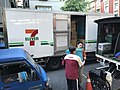 7-Eleven Zendong Store Officer Taking Boxes from Driver of President Logistics International 20170727.jpg