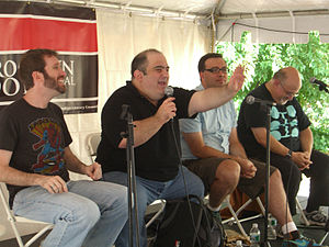 Dan Slott - Slott speaking on a panel on comic book writing at the 2009 Brooklyn Book Festival. To Slott's right is Jim McCann, and to his left are Fred Van Lente and Peter David.