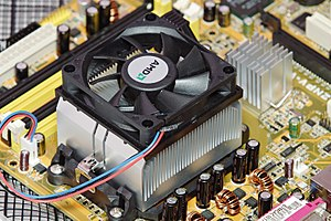 An OEM AMD heatsink mounted onto a motherboard.