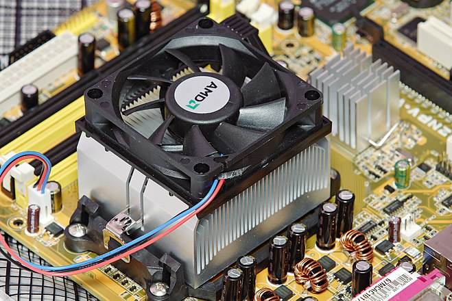 A fan-cooled heat sink on the processor of a personal computer. To the right is a smaller heat sink cooling another integrated circuit of the motherboard. AMD heatsink and fan.jpg