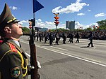 A Belarusian soldier provides an honor guard as 34 airmen from the U.S. Air Forces in Europe Band march in the World War II Victory Day Parade in Minsk, Belarus.jpg