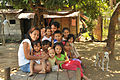 A Filipino family gathers to watch U.S. and Philippine military engineers perform a site survey for a new footbridge March 18, 2013, in Salaza village, Philippines 130318-N-FI367-077.jpg