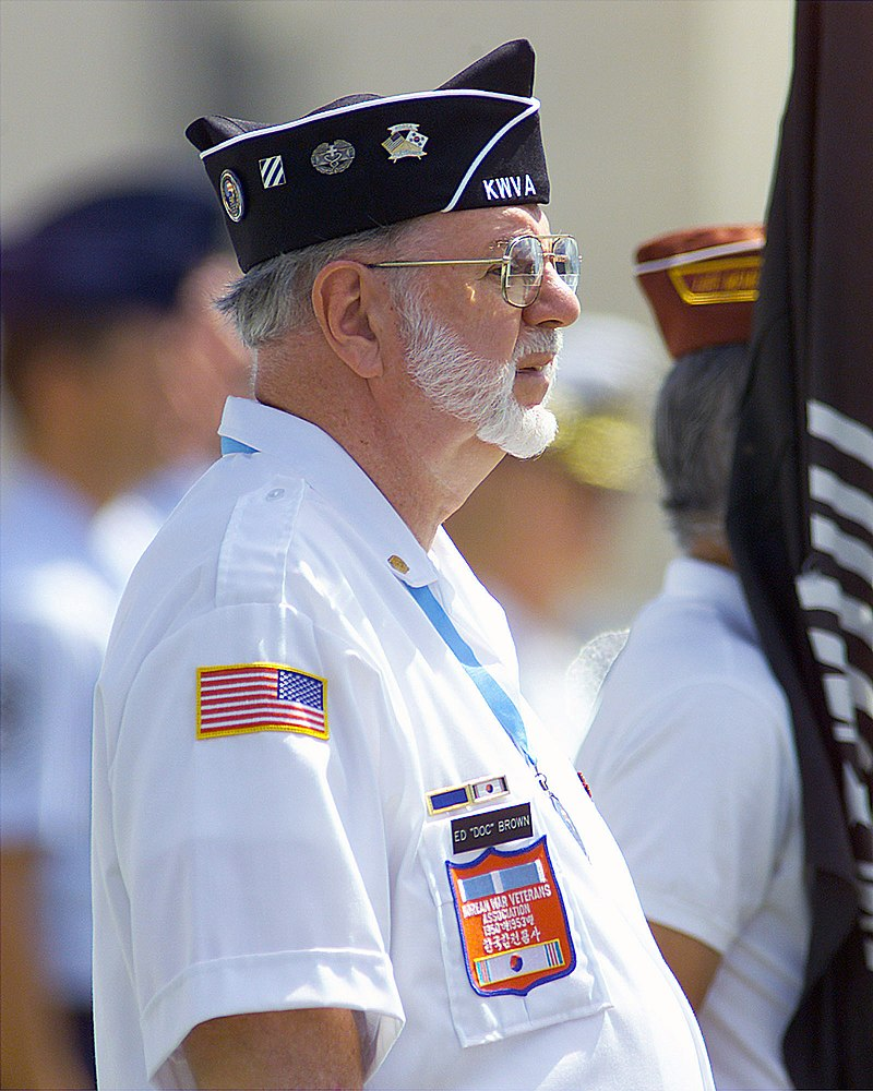 A Korean War Veteran, Ed %22Doc%22 Brown stands at attention during a repatriation ceremony held July 10, 2001 at Hickam AFB, Hawaii 010710-F-TV770-002.jpg