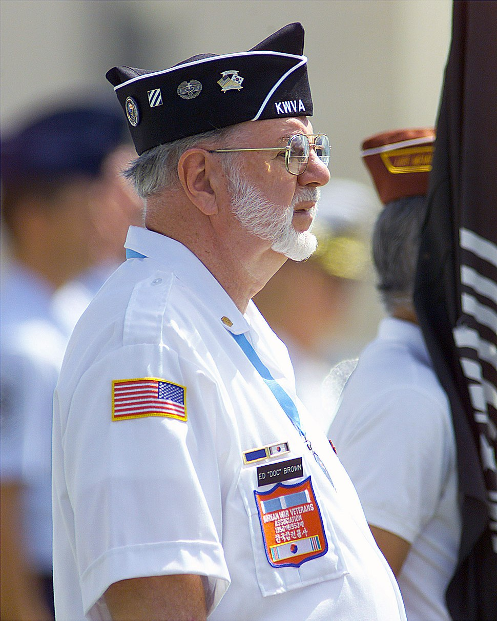 A Korean War Veteran, Ed %22Doc%22 Brown stands at attention during a repatriation ceremony held July 10, 2001 at Hickam AFB, Hawaii 010710-F-TV770-002