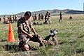 A Mongolian service member participates in a practice run for a pepper spray qualification course during Non-Lethal Weapons Executive Seminar (NOLES) 13 at Five Hills Training Area, Mongolia, Aug. 21, 2013 130821-M-DR618-014.jpg