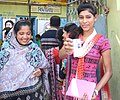 A first time female voter displaying identity card at a polling booth, during the fifth phase of West Bengal Assembly Election, at Kolkata Port constituency of Kolkata South on April 30, 2016.jpg