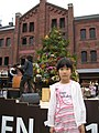 A girl in front of red brick warehouse, Kanagawa, Japan; May 2011.jpg