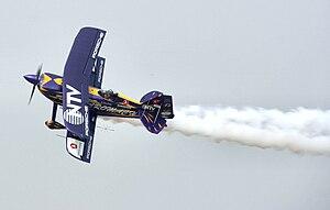 "Ali İsmet Öztürk - Ali İsmet Öztürk piloting his special biplane called ""Purple Violet"" at the Kraków Air Show, 2007"