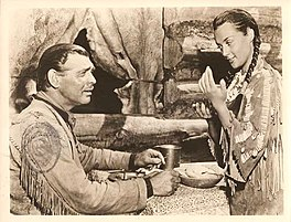 Clark Gable as Flint Mitchell en María Elena Marqués as Kamiah yn Across the Wide Missouri.