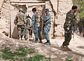 Afghan National Security Forces enter a house during a cordon and search operation in the Panjwai district, Kandahar province, Afghanistan, April 1, 2012 120401-A-VQ566-710.jpg