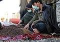 Afghan workers sort through raisins (4382102563).jpg