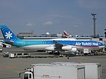 Air Tahiti Nui A340-313 (F-OLOV) parked at Narita International Airport.jpg