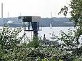 Alexandra unterhalb im Bootshafen der MSM, mit Werft im Hintergrund (Flensburg-Mürwik 2006).jpg