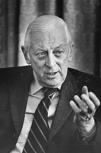 Alistair Cooke, head-and-shoulders portrait, facing front, gesturing with left hand, during interview, March 18, 1974.jpg