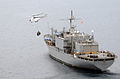 An AS-332 Super Puma helicopter flies a pallet of bottled water from USNS Niagara Falls (T-AFS 3) while under way off the coast of the Philippines June 29, 2008, to Kalibo, Philippines, during humanitarian 080629-N-HX866-008.jpg