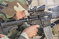An Afghan National Army commando with the 1st Tolai, 7th Special Operations Kandak fires at a target during close quarters combat training in the Washir district of Helmand province, Afghanistan, May 8, 2013 130508-A-VX870-001.jpg