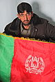 An Afghan Uniform Police Chief holds a flag of Afghanistan, in Pul-e Alam district, Logar province, Afghanistan, Jan. 26, 2012 120126-A-BZ540-014.jpg