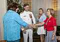 An Evening Parade guest of honor, Vice Chief of Naval Operations Adm. Mark E. Ferguson III, second from left, stands by as his wife greets the Second Lady of the Marine Corps, Debbie Paxton, left, during 130607-M-NK962-038.jpg