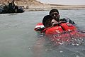 An Iraqi policeman drags a classmate toward shore during rescue swimming and conditioning training in Lake Quadsiyah in Haditha, Iraq, July 9, 2008 080709-M-QJ743-010.jpg