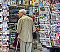 An old man in newsagent's shop, Paris September 2011 - crop.jpg