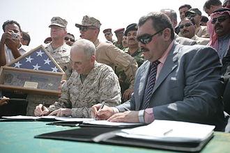 Maamoon Sami Rasheed al-Alwani - Maj. Gen. John Kelly and  Gov. Maamoon Sami Rasheed al-Alwani sign provincial Iraqi control documents on Sep. 1, 2008.