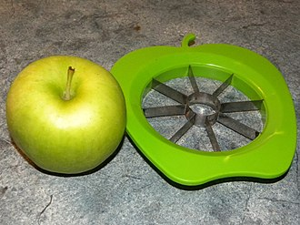 Apple corer - An apple with a corer and slicer