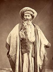 Arab man smoking pipe, late 1800s.