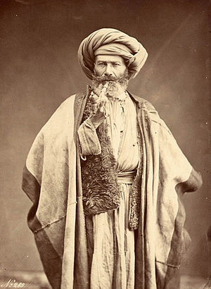 Félix Bonfils - Photo of an Arab man with a pipe, taken by Félix Bonfils.