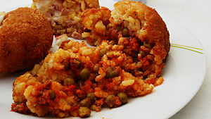 Arancini - An open arancino, showing the rice and ragù stuffing