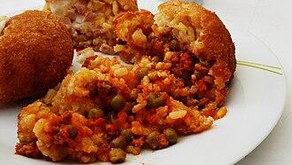 Arancini - An open arancino, showing the rice and ragù stuffing