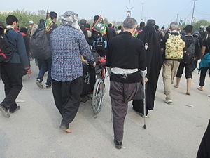Arba'een Pilgrimage - Handicapped men participating Arbaeen pilgrimage, going from Najaf to Karbala on foot