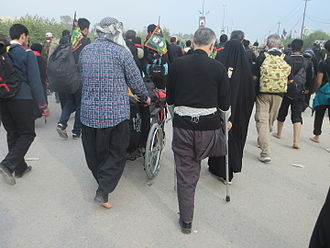 Arba'een Pilgrimage - Handicapped men participating in the Arba'een Pilgrimage between Najaf and Karbala on foot