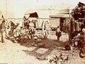 Archivo General de la Nación Argentina 1890 aprox, Carretas descargando en la estación de tren.jpg