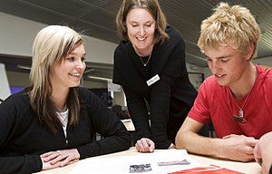 Teacher - A teacher interacts with older students at a school in New Zealand