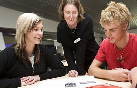 A teacher interacts with older students at a school in New Zealand Ashs-teacher-and-students.jpg