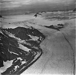 Bear Glacier, icefield, bergschrund, and firn line in the background, and valley glacier in the foreground, September 4, 1977 (GLACIERS 6821).jpg