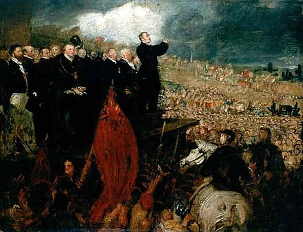 Thomas Attwood addressing a 200,000-strong meeting of the Birmingham Political Union during the Days of May, 1832 Benjamin Haydon - Meeting of the Birmingham Political Union.jpg